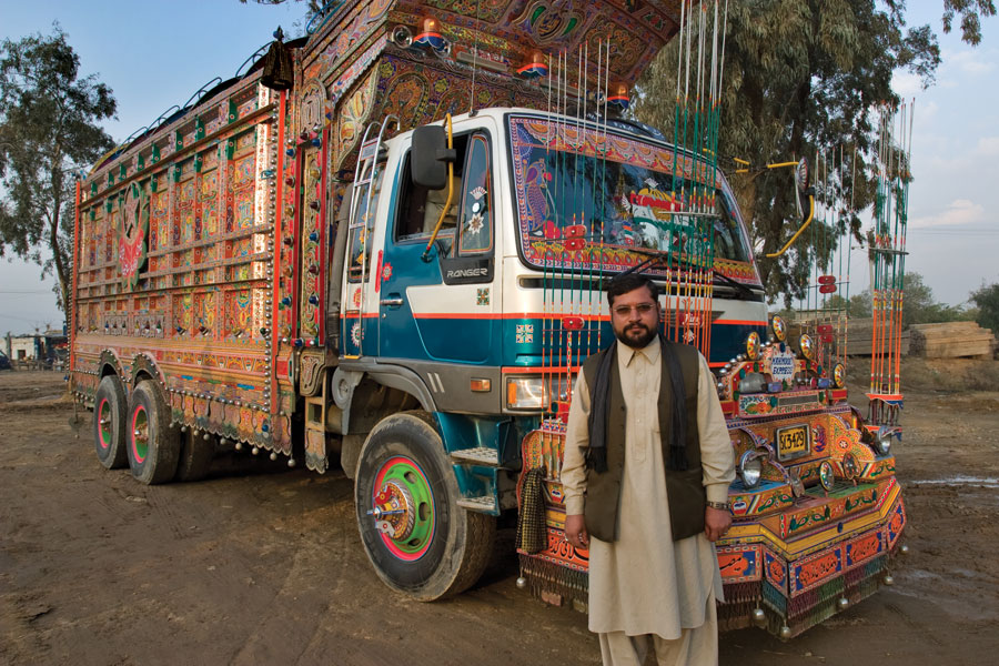 A painted truck with its owner, Mazhar Ali Khan, Pakistan, 2007